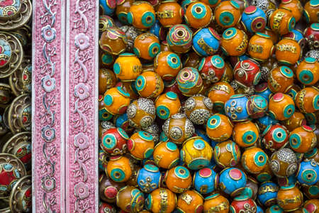 Bright colorful yellow round beeds for handmade jewellery, market stall in Istanbul, Grand Bazaar