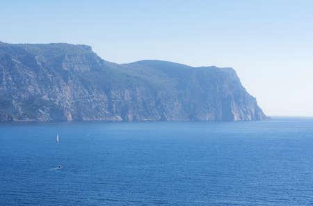 Cape Aya in Balaklava Bay, Crimea. Travel to Crimea. Seascape with a mountain.