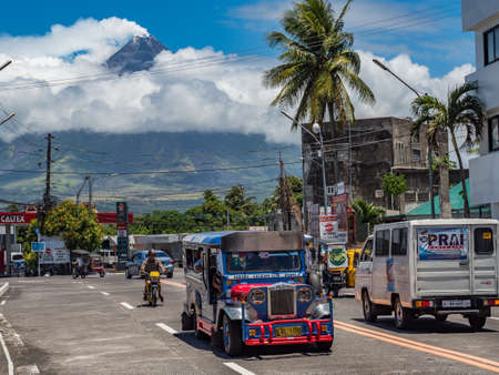 MAYON VOLCANO, perfect cone shape volcano nad local filipon life, Legazpi, Luzon, Albay, Philippines - 24/04/2019