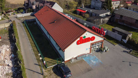 NIECHORZE, REWAL, BALTIC SEA, POLAND - 07/04/2020: DINO supermarket, brand name, brand logo, shopping, chain shop