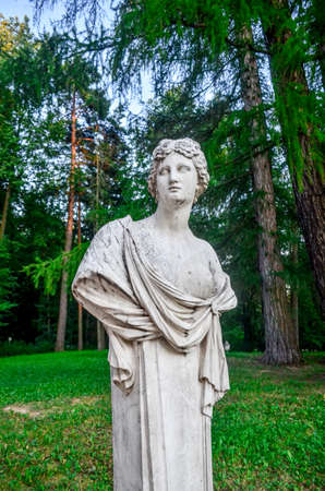 Marble statue in green park in Moscow Фото со стока