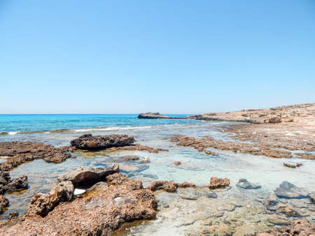 Picturesque and gorgeous scene of rocky coast on a sunny day with blue sky.