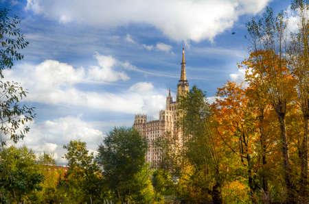 Golden autumn scene in park with wonderful sky