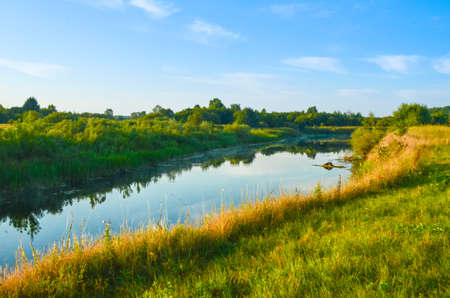 Countryside landscape with river at sunny morning Фото со стока