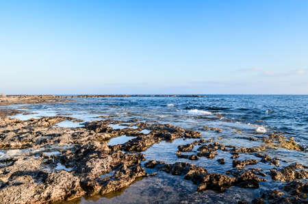 Rocky beach at warm sunny summer day Фото со стока