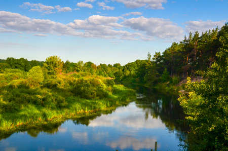 Countryside landscape with river at sunny day