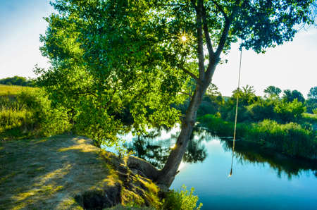 Summer river with bright blue sky, russia