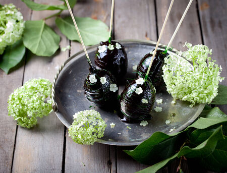Easter eggs decorated with dark green caramel and flowers photo