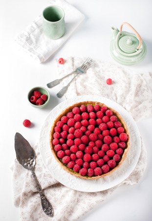 Fresh raspberry and pistachio cream tart photo