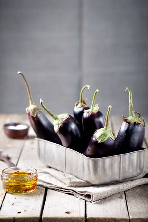 metal box: Eggplants in a vintage metal box on a wooden background
