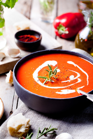 Tomato, red pepper soup, sauce with olive oil, rosemary and smoked paprika 스톡 콘텐츠