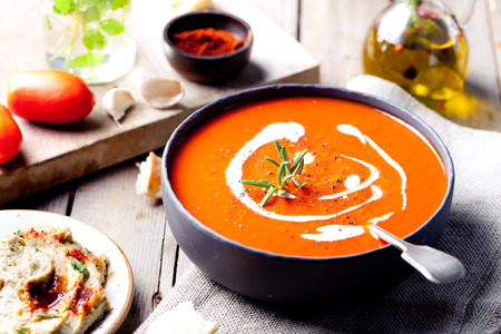 Tomato, red pepper soup, sauce with olive oil, rosemary and smoked paprika Archivio Fotografico