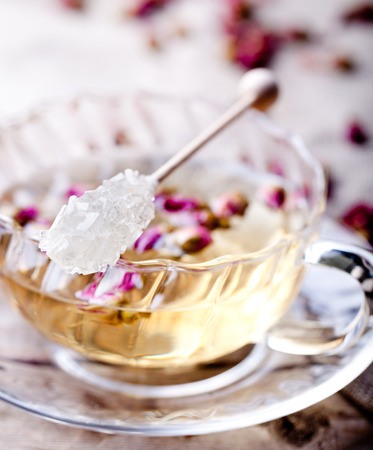 Rose buds herbal tea in a glass cup