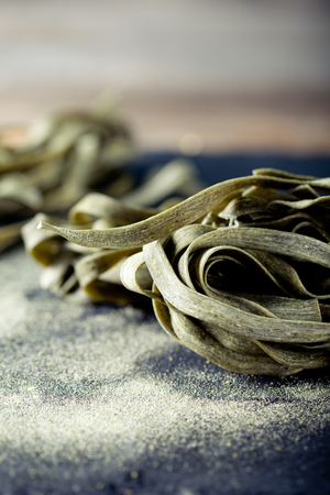 sea weed: Green tea and sea weed pasta on a stone plate with matcha powder