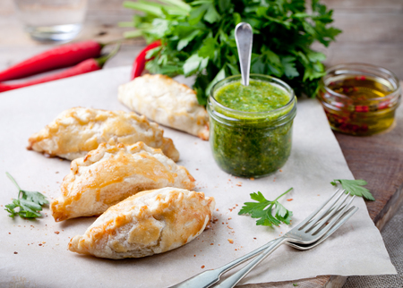 chili sauce: Empanadas with ground meat and green chili sauce. Traditional mexican dish. Stock Photo