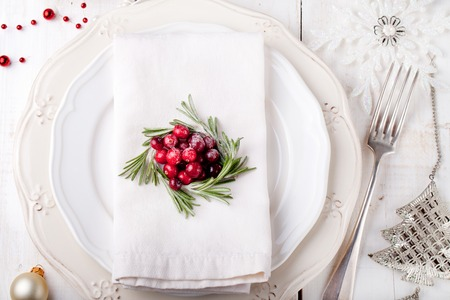 tree of life: Christmas And New Year Holiday Table Setting with cranberry and rosemary decoration. Holiday decoration.