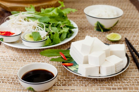 chinese herbs: Fresh tofu with rice, salad and soy sauce on a wooden background Stock Photo