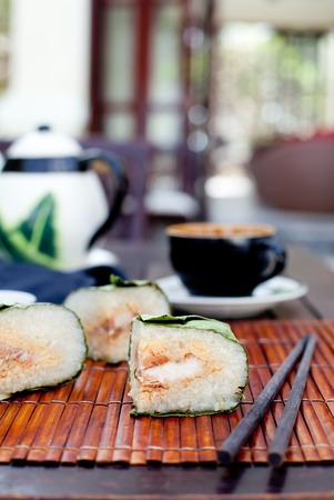 holiday food: Banh chung, Traditional present for Lunar New Year, Vietnamese traditional dish. Sticky rice cake with meat, covered with banana leaves and, tied with bamboo rope