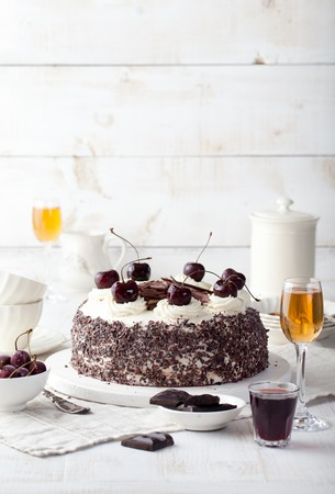 dessert plate: Black forest cake, Schwarzwald pie, dark chocolate and cherry dessert on a white wooden background Stock Photo