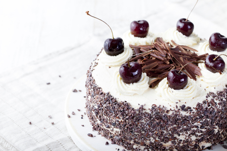 Black forest cake, Schwarzwald pie, dark chocolate and cherry dessert on a white wooden background Foto de archivo
