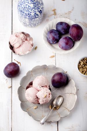 cardamon: Plum ice cream with cardamon seeds on a white background