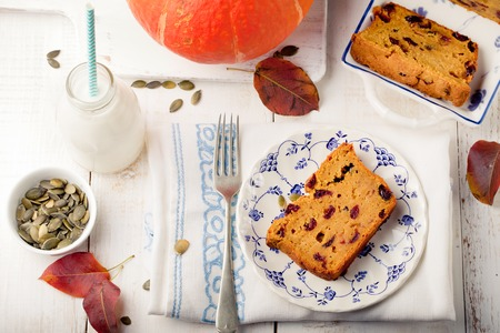 to seem: Pumpkin seem bread, loaf, cake with cranberries on a white wooden background Stock Photo