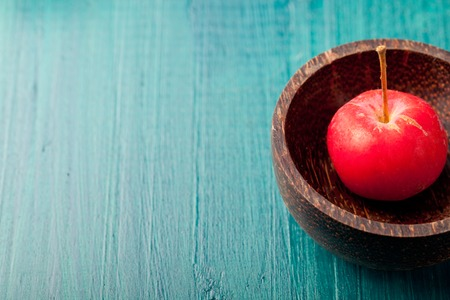 apple green: Red apples and leaves on a wooden blue, turquoise background