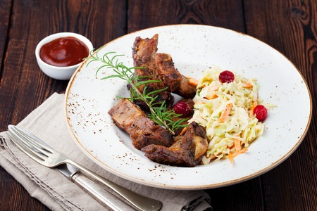 cole: Grilled sliced barbecue pork ribs with cabbage salad cole slaw Stock Photo