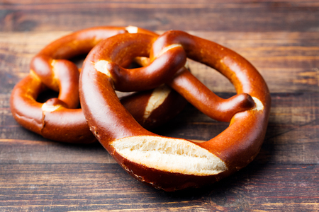 Freshly baked soft pretzel from Germany on wooden background