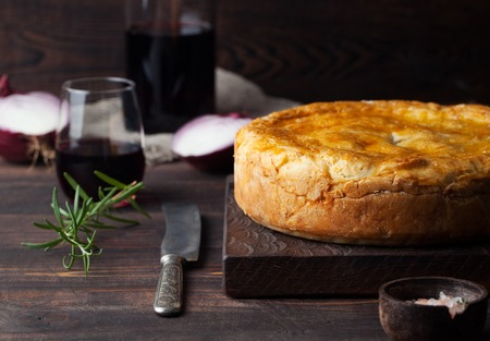 meat pie: Pot Meat Pie with wine Wooden background Copy space Stock Photo