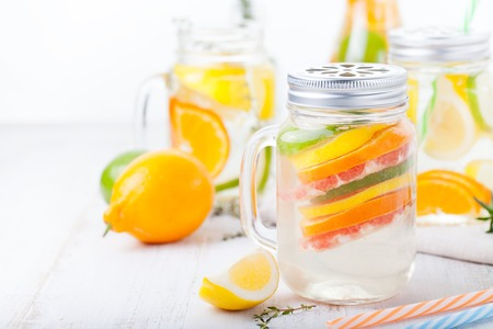 cleanse: Detox fruit infused flavored water. Refreshing summer homemade lemonade cocktail Cleanse body and burn fat Stock Photo