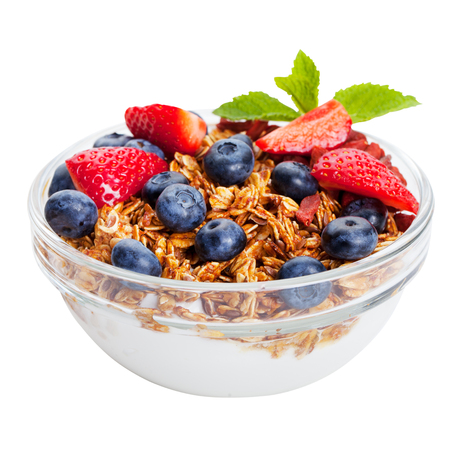 Healthy breakfast Fresh granola, muesli in bowl with berries. Isolated on white