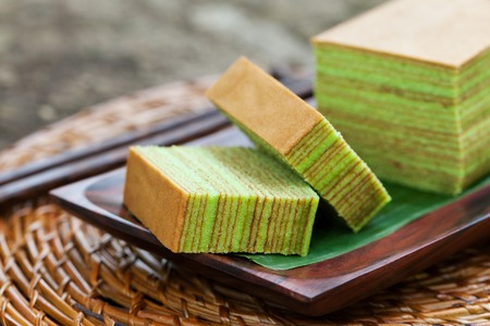Traditional Indonesian sweet Layer cake on a wooden background