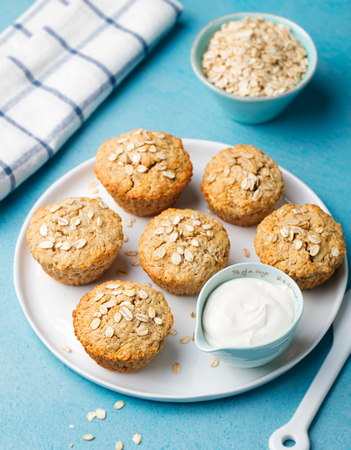 muffin: Healthy vegan oat muffins, apple and banana cakes with sour cream on a white plate Blue stone background