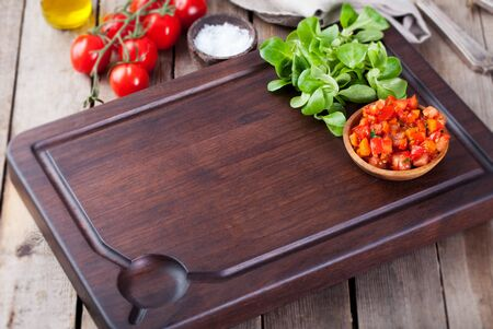 cutting bord: Salsa sauce and ingredients with fresh salad Dark steak cutting bord wooden background Copy space Stock Photo
