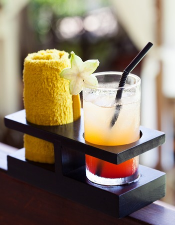 Tropical juice and cold towel, welcome drink in the hotel and spa Outdoor background Copy space
