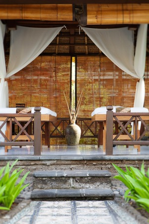 the place is outdoor: Place for relaxation in authentic asian wellness center Tropical outdoor background Copy space