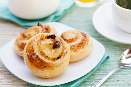 Romantic tropical breakfast Danish pastry, coffee, juice