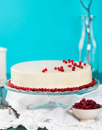 bilberries: Cranberry, bilberry, raspberry tart, mousse cake, pie, cheesecake with fresh bilberries on a blue wooden background Stock Photo