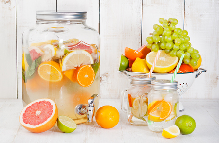 cleanse: Detox fruit infused flavored water, lemonade, cocktail in a beverage dispenser with fresh fruits Cleanse body and burn fat
