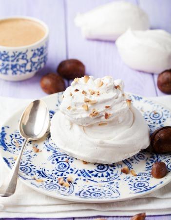 kiss biscuits: Meringue pavlova cake with chestnut cream on white background