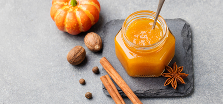 confiture: Pumpkin confiture, jam sauce with spices on stone table Stock Photo