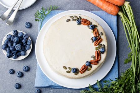 Vegan, raw carrot cake. Healthy food. Grey stone background Top view Copy space.