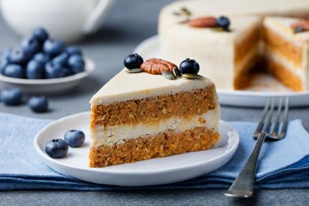 Vegan, raw carrot cake. Healthy food. Grey stone background Top view Copy space. Selective focus.