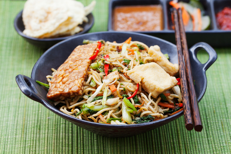 mi: Mi goreng,mee goreng Indonesian cuisine, spicy stir fried noodles with tempeh and assortment of asian sauces Stock Photo