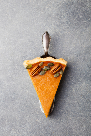 pecan pie: Pumpkin pie, tart made for Thanksgiving day. Grey stone background. Top view