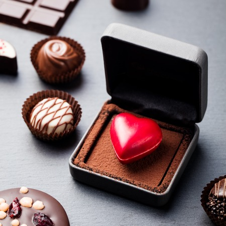 Heart shaped chocolate candy in a gift box.