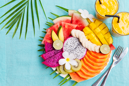Tropical fruits assortment with mango smoothie Reklamní fotografie - 73557025
