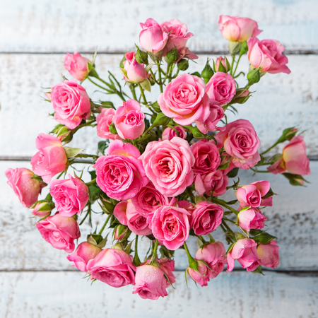 Rose flowers in vase. Beautiful romantic bouquet. Copy space. Top view