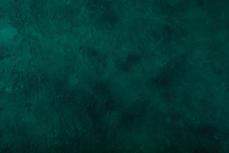 Dark green stone background. Top view. Copy space